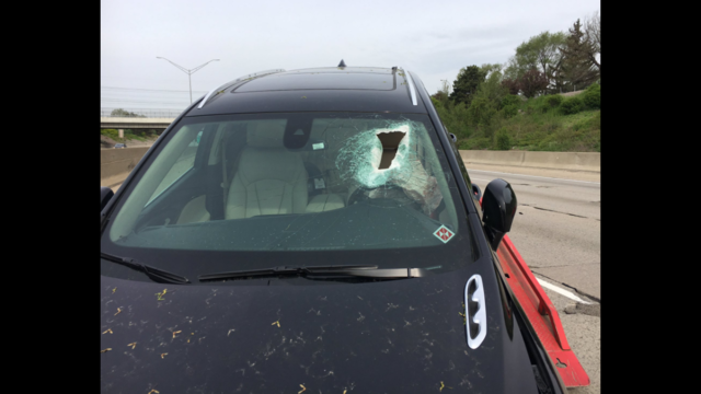 Concrete crashes through windshield, knocks driver unconscious