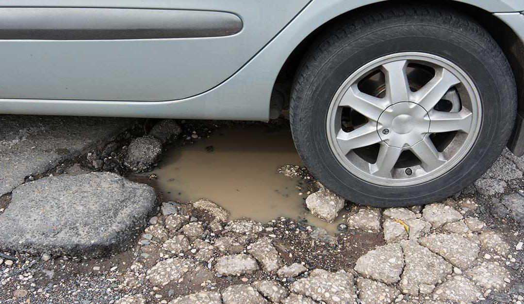 Warren gets $13 million loan to fix roads, including the pothole filled Ryan Road