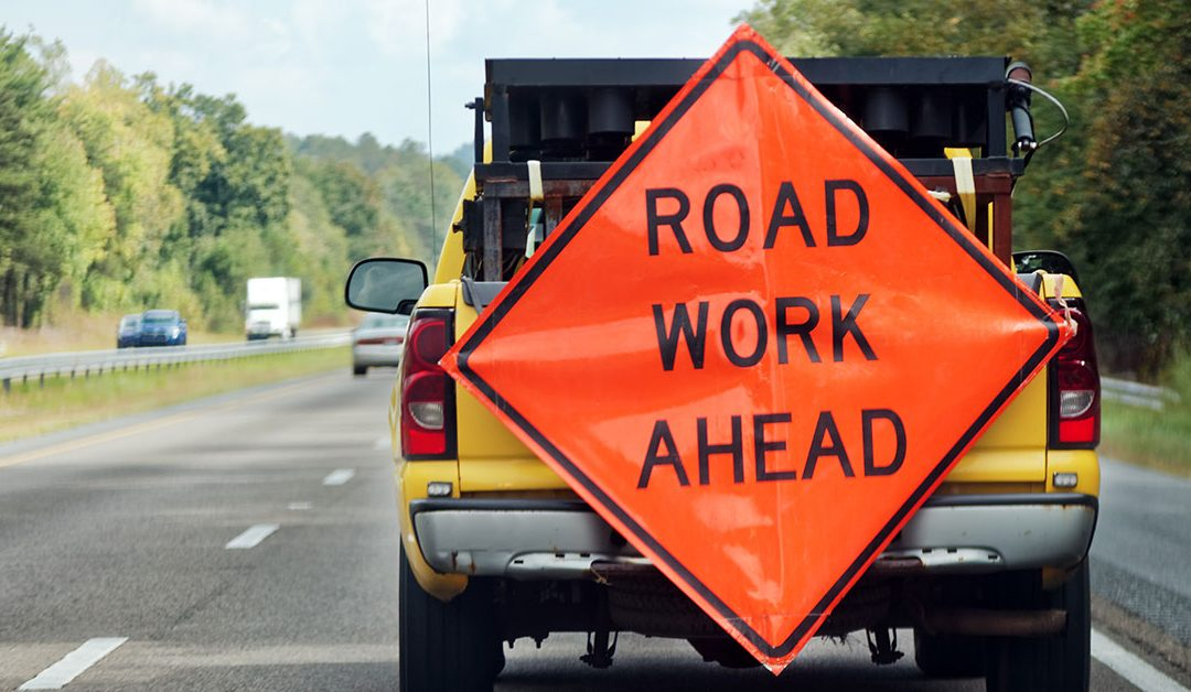 Lansing announces new plan to fix roads