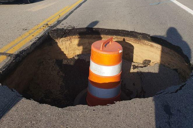 WOW! Massive hole opens up in Michigan road