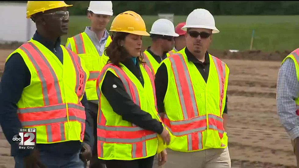 Whitmer highlights workers 'fixing the damn roads' in Saginaw County